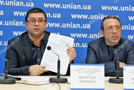 Ukrainian Patriots Association candidate for Mayor of Zaporozhye, Jaroslav Grishin and a party leader, Hennadiy Korban during a press conference on the results of local councils elections