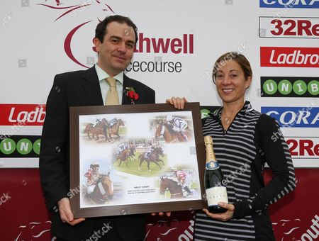 Stock Photo of Mark Clayton presenting Hayley Turner with a racing momento on her last day racing at Southwell Southwell