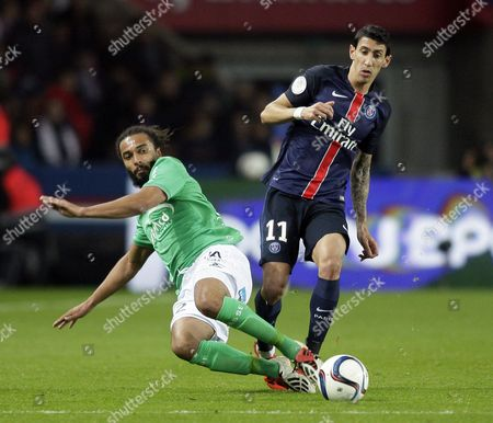 Stock Image of PSG forward Angel Di Maria fights for the ball with Saint-Etienne's defender, Benoit Assou-Ekotto (L)
