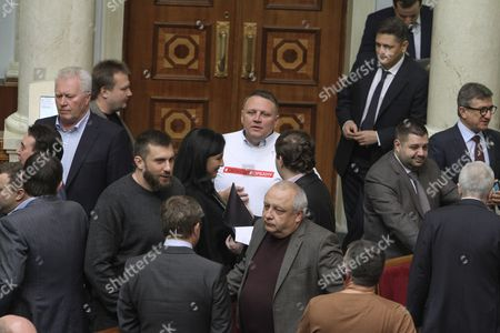 "Lawmaker dresses a t-shirt with the hashtag ""Freedom for Korban"" to support arrested former Deputy Governor of Dnipropetrovsk and Ukrainian UKROP party leader Hennadiy Korban during the parliamentary session of Verkhovna Rada"