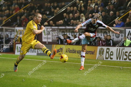 Stock Image of Fulham's jamie O'Hara blocks from Burnley's George Boyd during the Sky Bet Championship match between Burnley and Fulham played at Turf Moor on November 3rd 2015