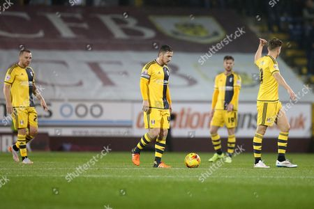 Jamie O'Hara, Ross McCormack, Ryan Tunnicliffe and Tom Cairney look dejected after Burnley score the opening goal during the SKY Bet Championship match between Burnley and Fulham played at Turf Moor, Burnley