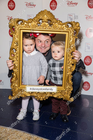 Chris Hollins with his niece Olivia and son George