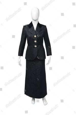 A black cocktail suit by Tomasz Starzewski worn by Baroness Margaret Thatcher on her 70th birthday party at Claridge's, October 1995, which was attended by H.M. Queen Elizabeth II. Woven with baroque motifs, the suit is trimmed with outsized pearl and paste floral buttons with a matching evening skirt. Estimate: £1,000-2,000