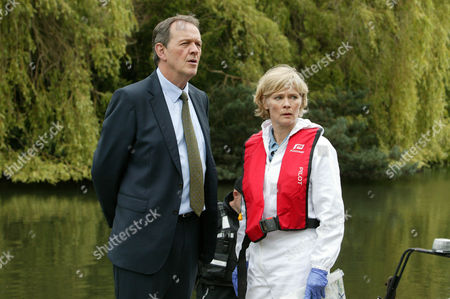 Kevin Whately as Lewis and Clare Holman as Dr Laura Hobson.