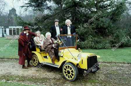 Stock Image of 'Dr Who' Photocall - 1983 Tom Baker [Model], Peter Davison, Jon Pertwee, Patrick Troughton and Richard Hurdall as William Hartnell, posing with the Dr Who car 'Bessie'