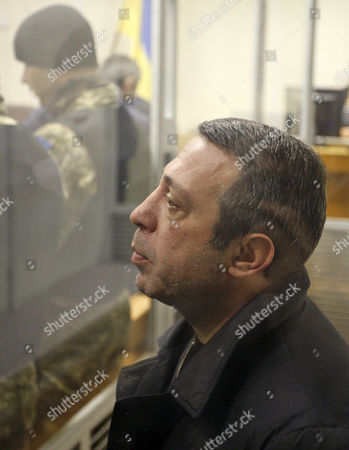 UKROP party leader Hennadiy Korban inside a cage during his trial