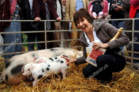Marina Lewycka is presented with a jeroboam of Bollinger Special Cuvee in the presence of the customary pen of Gloucester Old Spot pigs,after winning the Bollinger Everyman Wodehouse Prize for Comic Writing at the Hay Festival.
