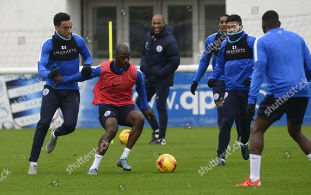 Samba Diakite holds off James Perch of QPR in training