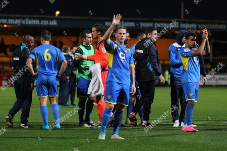 Stock Image of Glen Southam of Basingstoke (C) thanks the travelling fans at the final whistle during Cambridge United vs Basingstoke Town, Emirates FA Cup Football at the Abbey Stadium, Cambridge