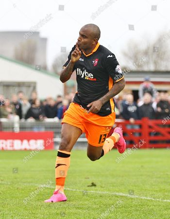 Clinton Morrison of Exeter celebrates scoring the opening goal   during the FA Cup First  Round  match between Didcot Town and Exeter City    played at Loop Meadow Stadium , Didcot on 8 November 2015