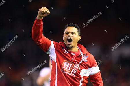 John Salako celebrates victory at the end of the Barclays Premier League match between Liverpool and Crystal Palace played at Anfield, Liverpool