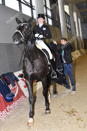 Thomas Muller and wife Lisa Muller riding their horse Dave