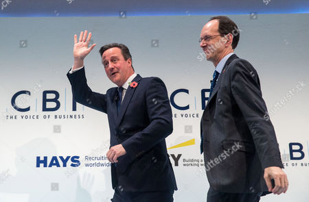 David Cameron leaves with John Cridland, Director General of the CBI, after his keynote address at the CBI conference