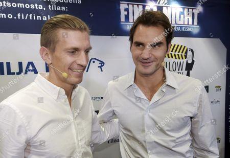 Jarkko Nieminen and  Roger Federer