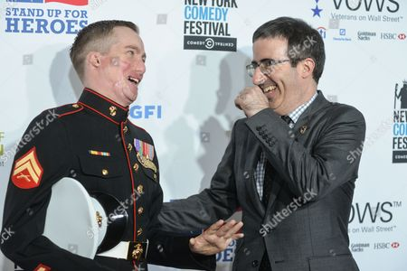 Marine corporal Aaron Mankin and comedian John Oliver