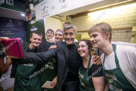 George Clooney visits Social Bite sandwich shop in Edinburgh where he met owner Josh Littlejohn and Alice Thompson and formerly homeless staff