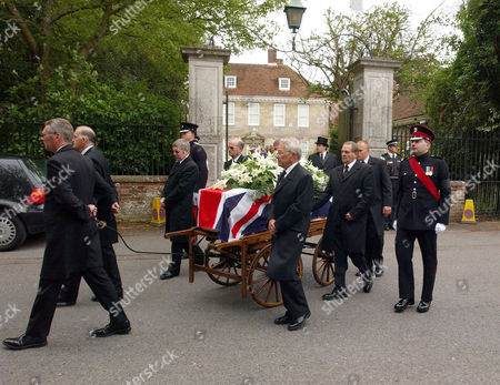 The Coffin leaves the home of Edward Heath in the Close at Salisbury Cathedral.