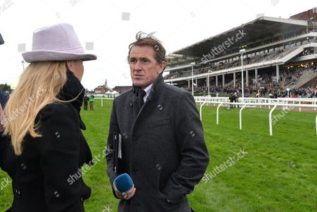 Tony McCoy, former champion jump jockey, commentating for Channel 4 Racing with Emma Spencer @ Cheltenham Racecourse. Pic: Hugh Routledge. 14.11.5