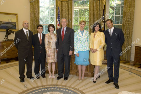 Stock Image of George W. Bush welcomes representatives from the Colombian - American community and the government of Colombia into the Oval Office. From left are: Augusto D'Avila, a veteran of Operation Iraqi Freedom; Colombia Ambassador Luis Alberto Moreno and his wife, Gabriela Fedres Cordero; President Bush, Carolino Barco, Foreign Affairs Minister of Colombia; Gloria Haskins and actor Paulo Benedeti. - 20 Jul