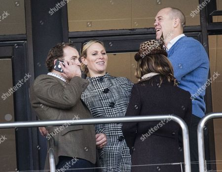 Zara Tindall, husband Mike Tindall and James Simpson Daniel watch the Opus Engery Novices Handicap Hurdle race