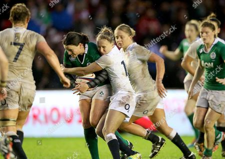 Ireland's Jackie Shiels tackled by Emily Scott of England