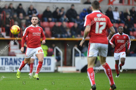 Swindon Town midfielder Anton Rodgers passes the ball during the Sky Bet League 1 match between Swindon Town and Scunthorpe United at the County Ground, Swindon