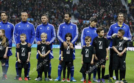 Mikael Silvestre, Ole Gunnar Solskaer, Robert Pires, Raimond van der Gouw and the rest of the World football team