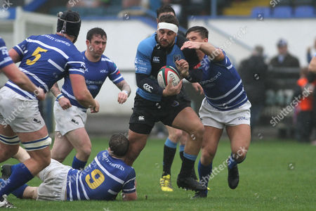 FosterÕs Challenge Cup Luke Ford of Cardiff takes onWill Baird(9) and Liam Jones  of Bridgend