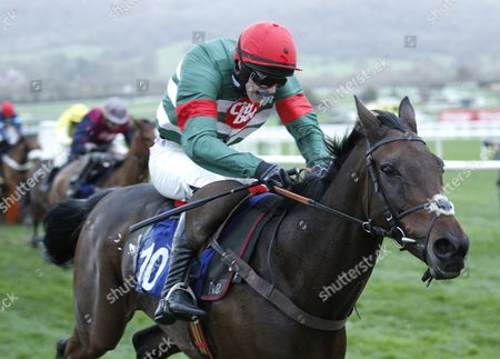 Unowhatimeanharry gives jockey Liam McKenna his first Cheltenham winner in the Celebrating 20 Years of Jets Open Conditional Jockeys Handicap Hurdle.