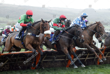 UNOWHATIMEANHARRY (centre, Liam McKenna) jumps with BROOK (right) and CRAZY JACK (left) on his way to winning The Celebrating 20 Years Of Jets Conditional Jockeys Handicap Hurdle Cheltenham