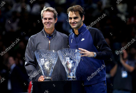 Roger Federer of Switzerland receives the Stefan Edberg Sportsmanship award from the man himself at the ATP World Tour Finals, The O2, London, 2015