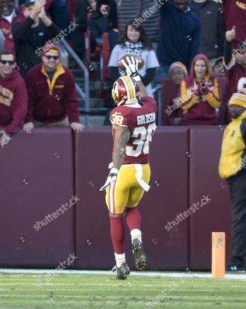 Washington Redskins free safety Dashon Goldson (38) celebrates his fourth quarter interception that he ran back for a touchdown against the New Orleans Saints at FedEx Field in Landover, Maryland. The Redskins won the game 47 - 14.
