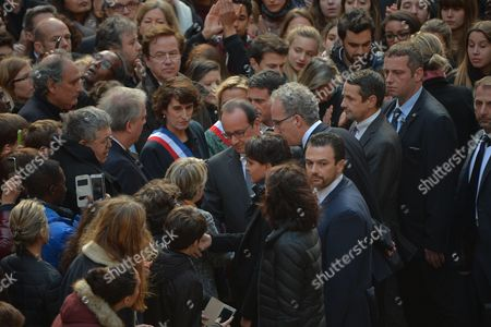 French President Francois Hollande along with Prime Minister Manuel Valls, Minister of Education, Higher Education and Research Najat Vallaud-Belkacem and Secretary of State for Higher Education and Research Thierry Mandon