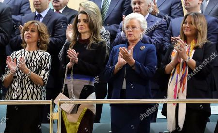 Jordanian Queen Rania 2nd (L) and King Abdullah II's mother Princess Muna al-Hussein (2nd R) claps at the opening.