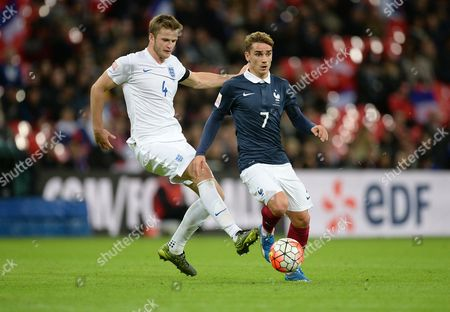 Antoine Griezmann of France attacks under pressure from Eric Dier of England