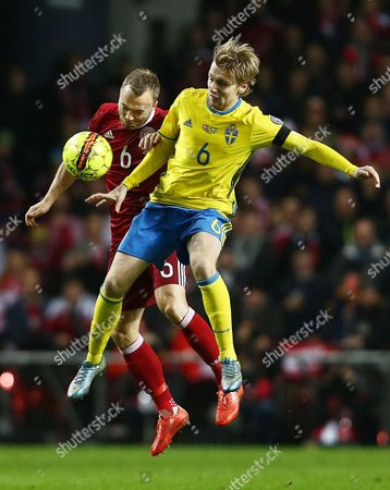 Stock Picture of Lars Jacobsen of Denmark and Emil Forsberg of Sweden during the UEFA EURO Qualifiers Second playoff round match between Denmark and Sweden played at the Telia Parken Stadium, Copenhagen on November 17th 2015