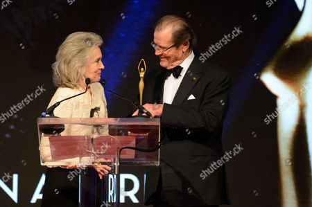 Lady Kristina Tholstrup and Sir Roger Moore
