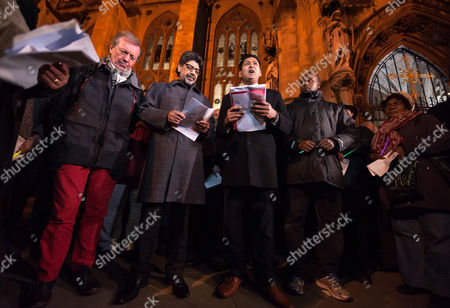Stock Picture of Vigil for the victims of the Paris terrorist attacks at Bristol Cathedral. Bristol's elected Mayor George Ferguson (left in red trousers) joins Religious and community leaders.