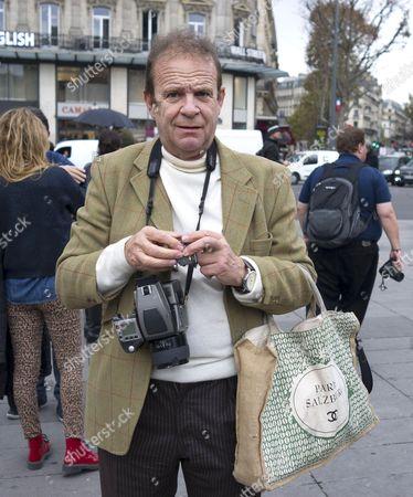 Francois-Marie Banier photographing tributes at the Place de la Republique