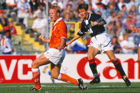 Football - 1992 European Championships - Group Two: Netherlands 1 Scotland 0 Holland's Ronald Koeman and Scotland's Kevin Gallacher at the Ullevi, Gothenburg, Sweden.