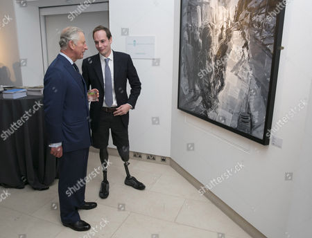 Stock Photo of Prince Charles with art student Harry Parker