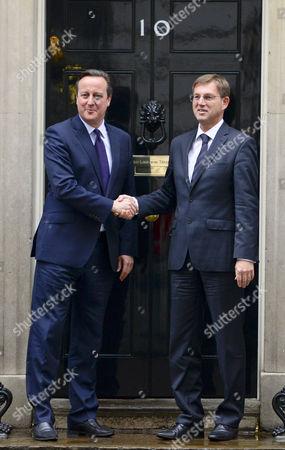 British Prime Minister David Cameron greets Miroslav Cerar the Prime Minister of Slovenia