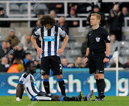 Cheik Tiote of Newcastle United goes down injured during the Barclays Premier League match between Newcastle United and Leicester City played at St. James' Park, Newcastle upon Tyne, on the 21st November 2015