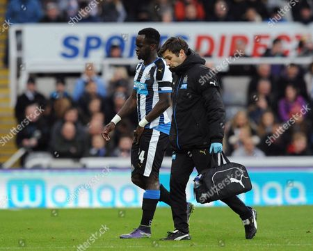 Cheik Tiote of Newcastle United goes down injured in the first half during the Barclays Premier League match between Newcastle United and Leicester City played at St. James' Park, Newcastle upon Tyne, on the 21st November 2015