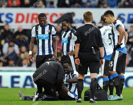 Cheik Tiote of Newcastle United gets treatment after going down injured during the Barclays Premier League match between Newcastle United and Leicester City played at St. James' Park, Newcastle upon Tyne, on the 21st November 2015