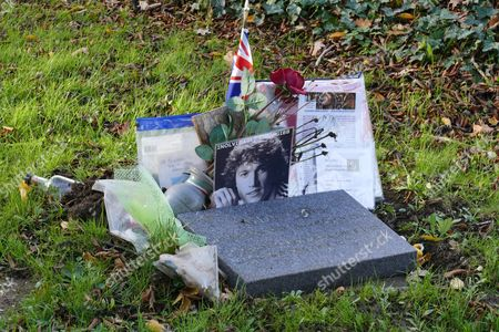 The grave of Andy Gibb with tributes from fans behind his brother Robin Gibb's grave
