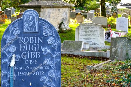 Stock Picture of Bee Gee Robin Gibb's grave with tributes from fans with his brother Andy's memorial behind it