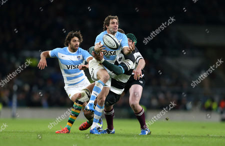 Argentina's Nicolas Sanchez is tackled by Victor Matfield of Barbarians.