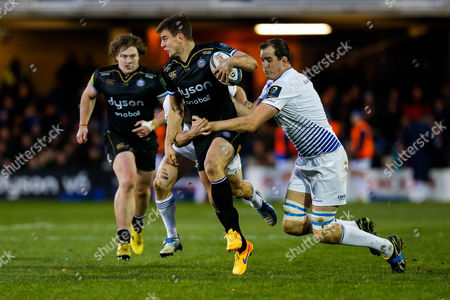 Bath Outside Centre Ollie Devoto is tackled by Leinster Lock Devin Toner